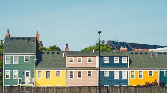 Decorative picture of colorful houses in a row.