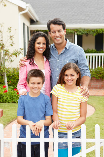young family of four in front of a house - Home purchase basics